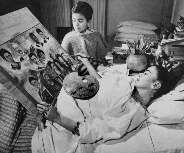"""PHOTOGRAPHY OF FRIDA KAHLO PAINTING """"RETRATO DE MI FAMILIA"""" VINTAGE PHOTOGRAPH.; Hospital Inglés, Mexico City, 1950. Cologne b. 1911, exiled, Germany, became resident of Mexico 1940, Mexico d. 1982."""